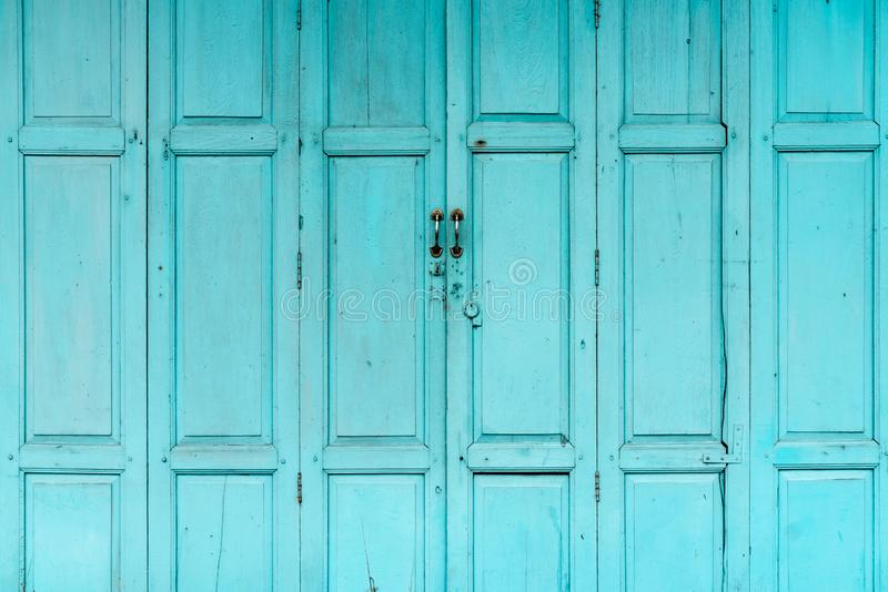 Closed green or blue wooden door. Vintage front door abstract background. Abandoned old house. Old wooden door texture royalty free stock images