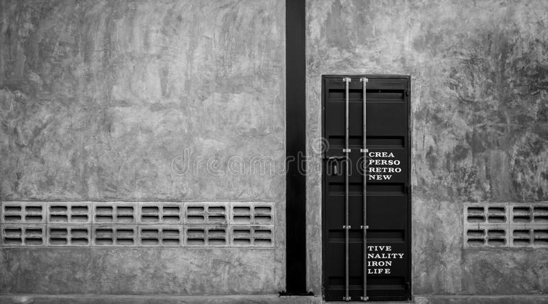 Closed iron door on concrete wall with ventilator, ,black and white scene royalty free stock images