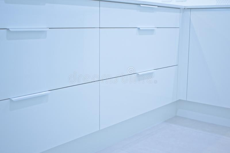 Closed kitchen drawers stock photos