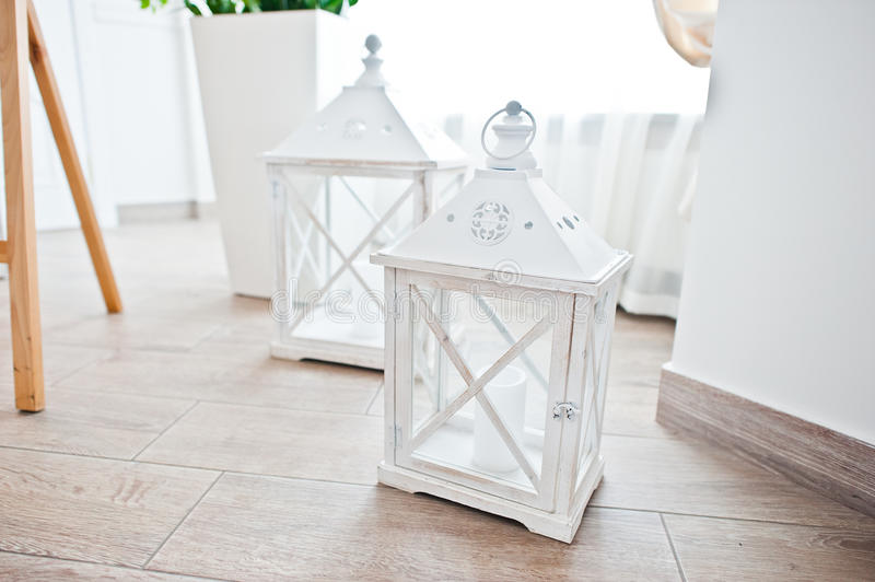 Closed lantern for candle at wooden box on wedding reception.  royalty free stock photos