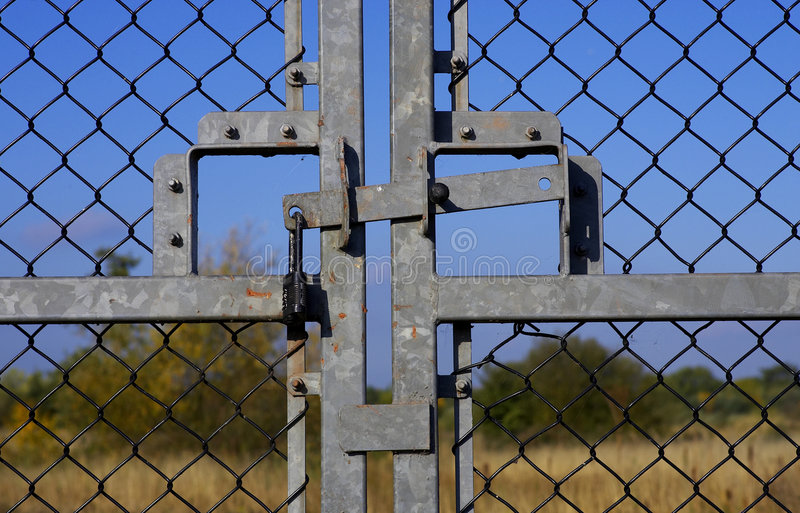 Closed and locked gates stock images