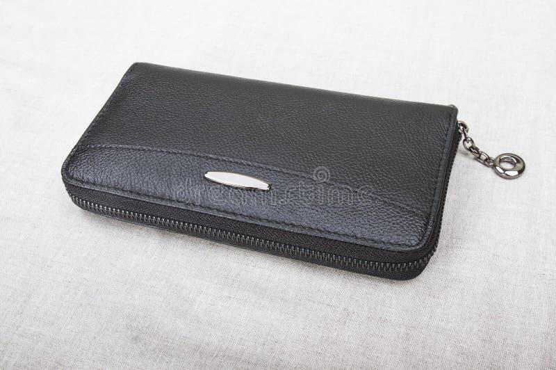 Closed men`s wallet; black purse stock image