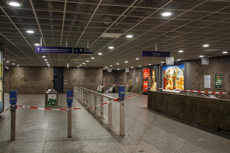 Closed metro station in Munich, Germany, 2015. The metro station at Karlsplatz (Stachus) in Munich was closed due to an unknown reason and barrier tape of the royalty free stock image