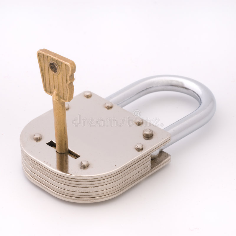 Closed old style padlock with key. Closed old style padlock isolated on white background stock image