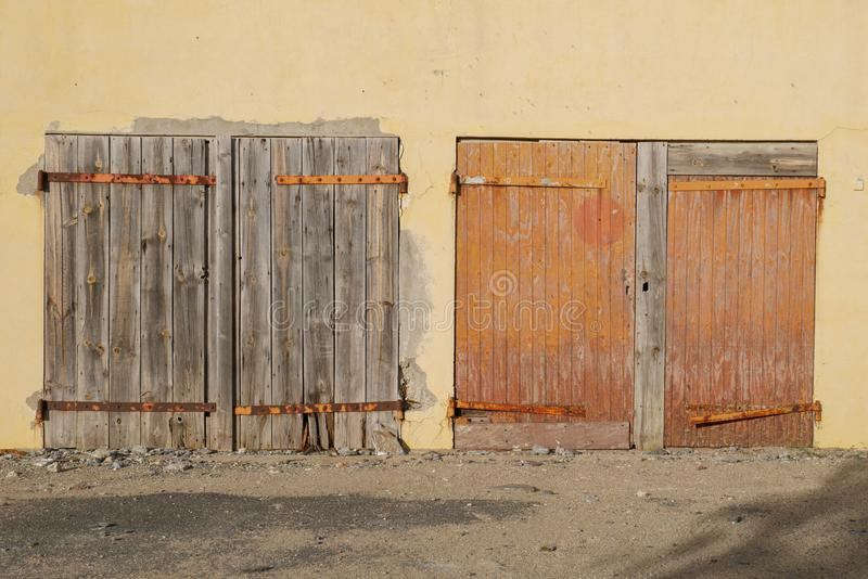 Closed old wooden doors, closed and abandoned building with rusty iron bar stock photo