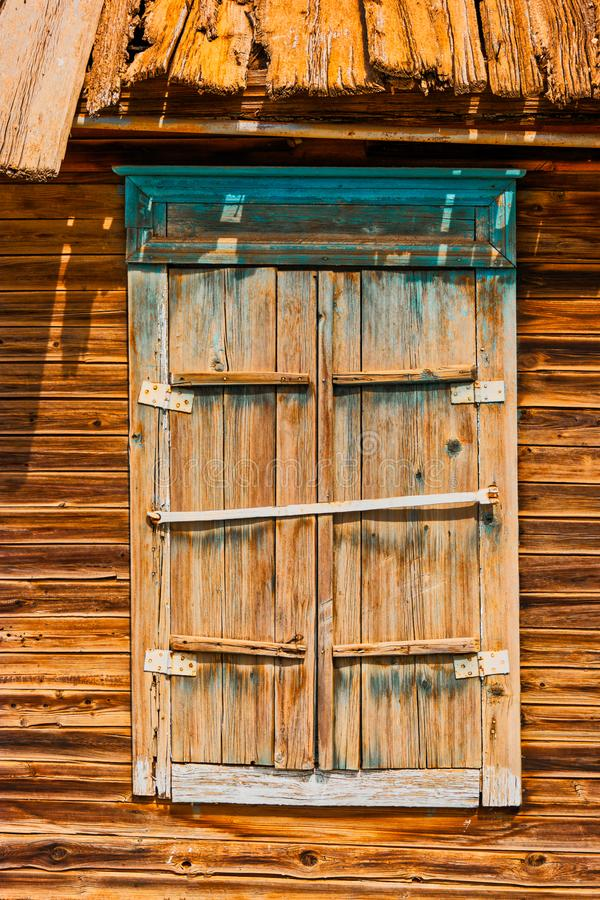 Closed shatters of wooden window made of weathered wood in Astrakhen Russia stock photo