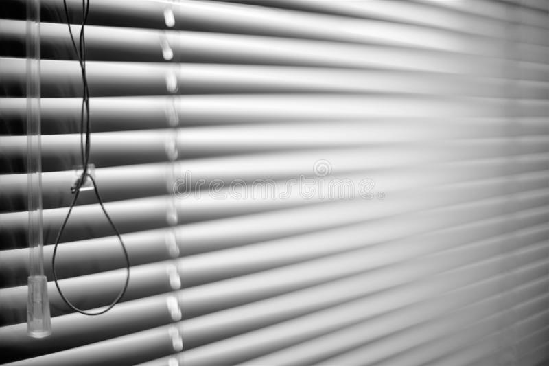 Closed shutters and rope. Jalousie background. Blinds bw royalty free stock photography