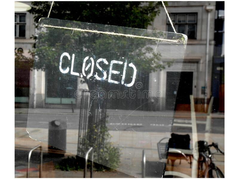 Closed sign in business window stock photos