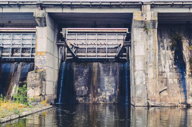 Closed sluices at the old small dam.  royalty free stock photos
