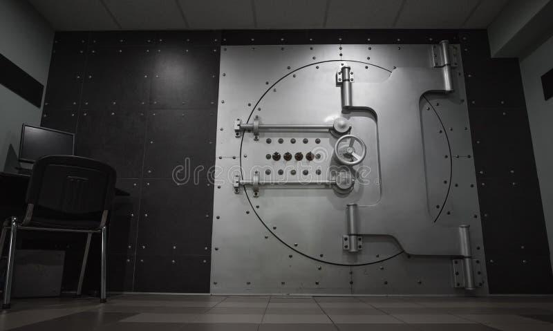 Closed steel bank vault door, close-up. Bank vault. Safe storage of valuables royalty free stock photos