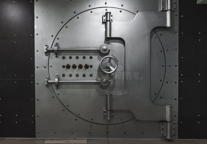 Closed steel bank vault door, close-up. Bank vault. Safe storage of valuables stock photos