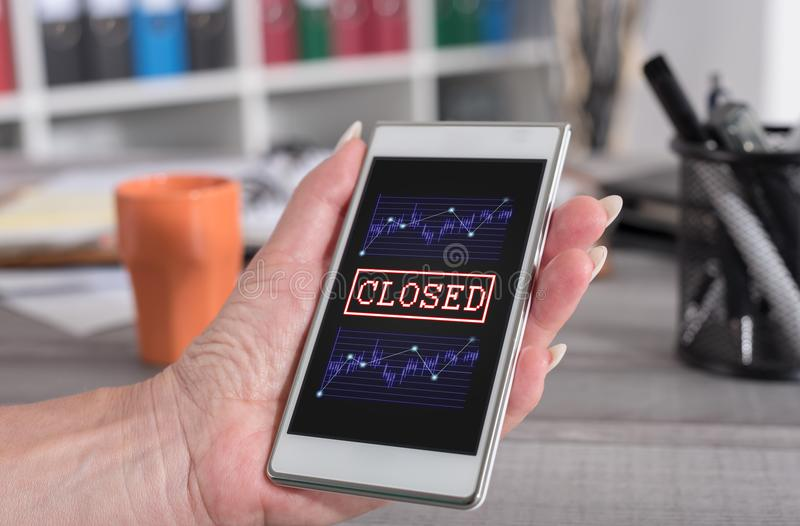 Closed stock market concept on a smartphone stock photos
