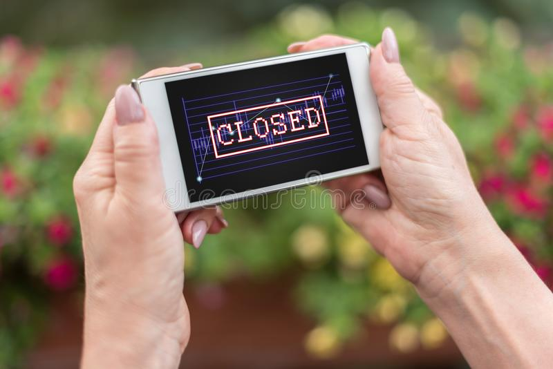 Closed stock market concept on a smartphone stock images