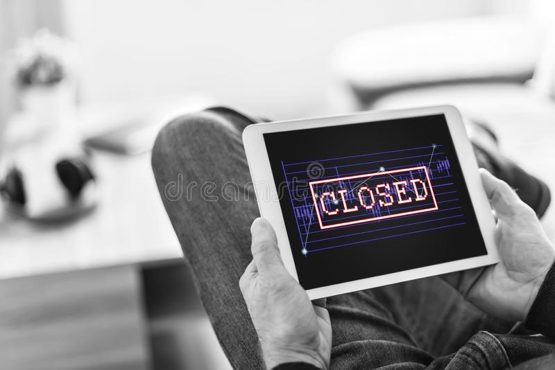 Closed stock market concept on a tablet stock images