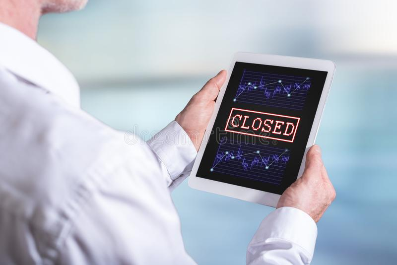 Closed stock market concept on a tablet royalty free stock photography