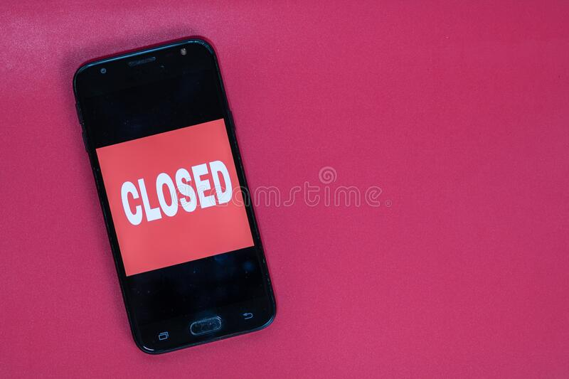 Closed text on the screen of a smartphone. Medical protective equipment isolated. Flu disease virus spreading, virus protection. Methods stock photography