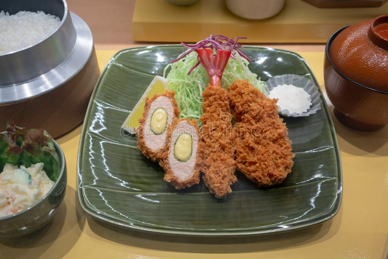 Closed up artificial model of Tonkatsu set served with rice in Japanese pot and soup royalty free stock images