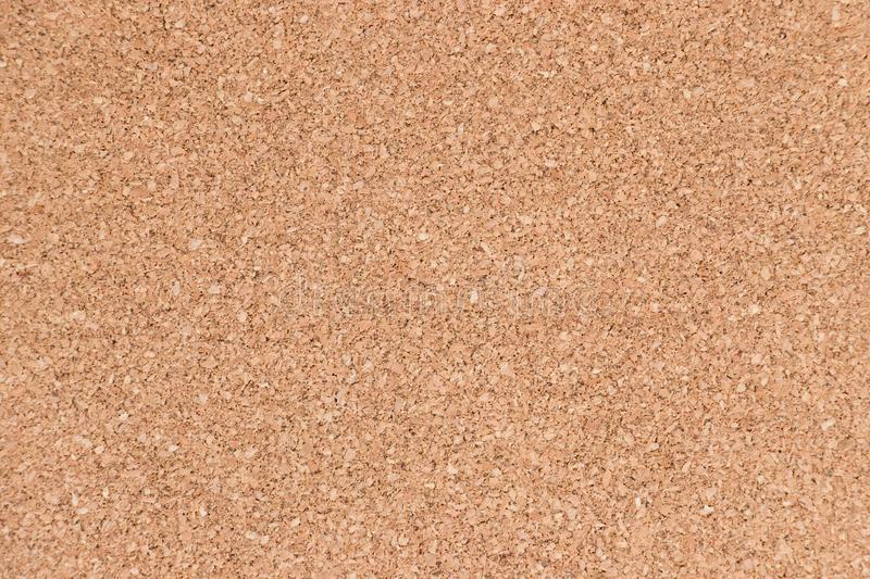 Closed up of brown color cork board texture background. Closed up of brown color cork board textured background royalty free stock photos