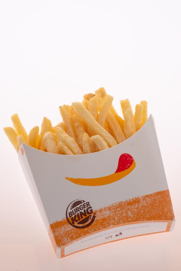 Closed up of Burger King's french fries on white background. Focus on Burger King's logo royalty free stock photos
