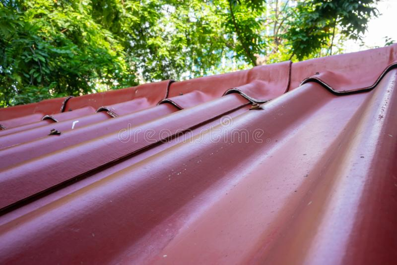 Closed up classic red roof tiles with cover against nature background royalty free stock photo