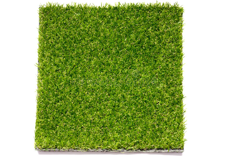 Closed up green artificial grass plate background royalty free stock photography