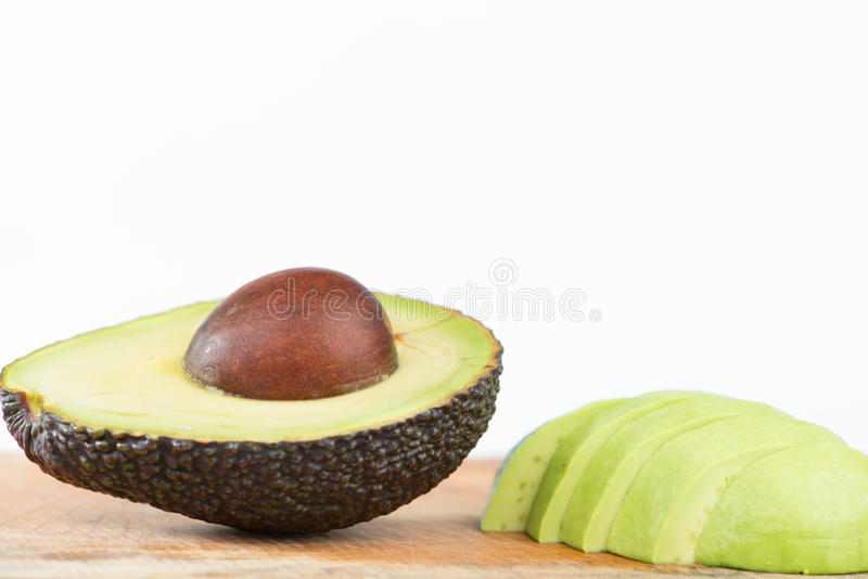 Closed up half of Avocado fruit on white.  royalty free stock image