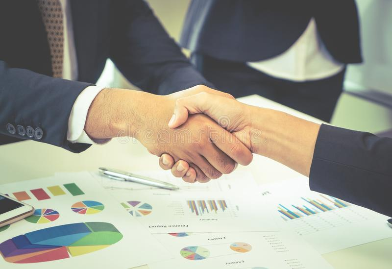 Closed up hand shaking in business deal. Closed up hand shaking in business financial deal stock photo