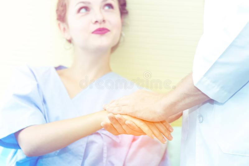 Closed up of Hands of doctor man reassuring woman patient on bed in  hospital .Professional medical doctor comforting patient at stock photos