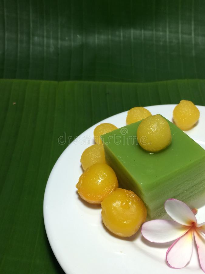 Thai sweet desert on green banana leafs. Closed up image of Thai sweet desert on green and fresh banana leafs royalty free stock photos