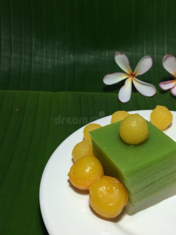 Thai sweet desert on green banana leafs. Closed up image of Thai sweet desert on green and fresh banana leafs royalty free stock photo