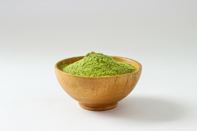 Closed up isolate heap of extract Green Tea powder in wooden bo. Wl. Natural taste and fresh smell. Appropriate for people who want to lose weight or meditaion stock image
