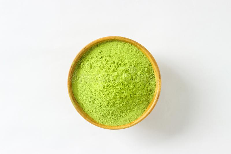 Closed up isolate heap of extract Green Tea powder in wooden bo. Wl. Natural taste and fresh smell. Appropriate for people who want to lose weight or meditaion royalty free stock photos