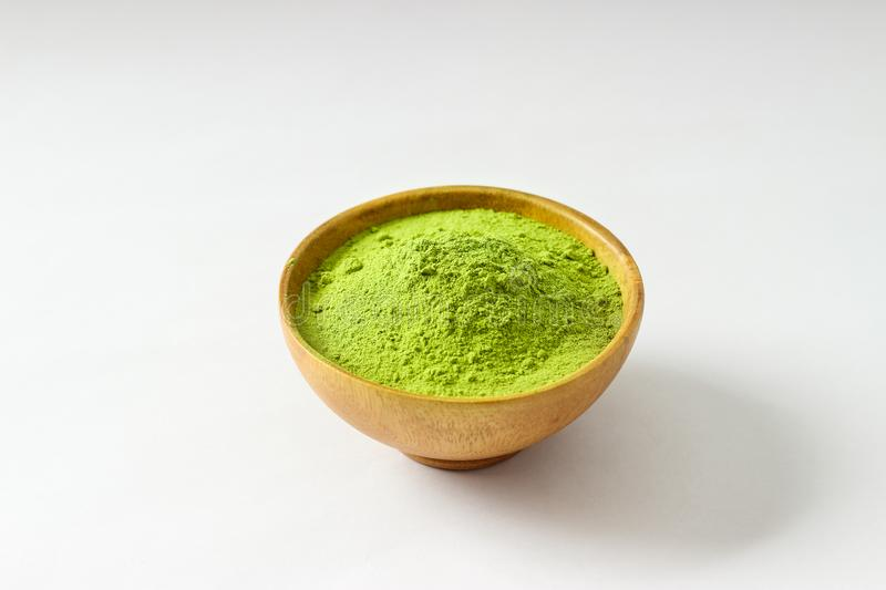 Closed up isolate heap of extract Green Tea powder in wooden bo. Wl. Natural taste and fresh smell. Appropriate for people who want to lose weight or meditaion royalty free stock photography