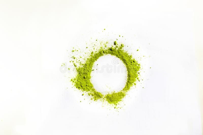 Closed up macro object, Isolate heap of circle extracted Green Tea Powder object white background. This is best natural ingredient stock photo