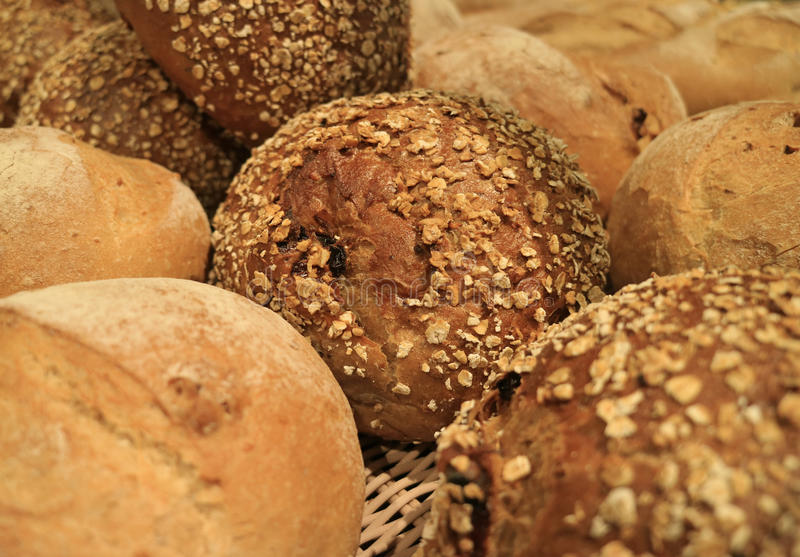 Closed up many types of whole grain bread loaves in the bakery stock photos