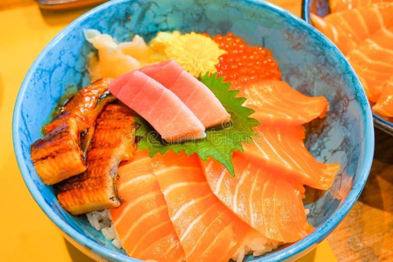 Closed up mix fresh raw secfood on topped rice bowl donburi. Japanese food royalty free stock photos