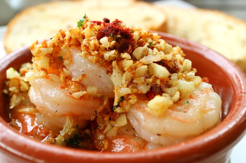 Closed-up of Mouthwatering Spanish Style Garlic Shrimp or Gambas al Ajillo stock images