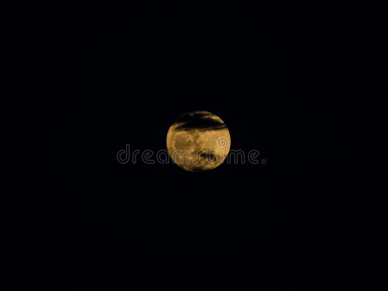 The closed up picture of giant moon in the supermoon phenomenon. From tele photograph len royalty free stock photo