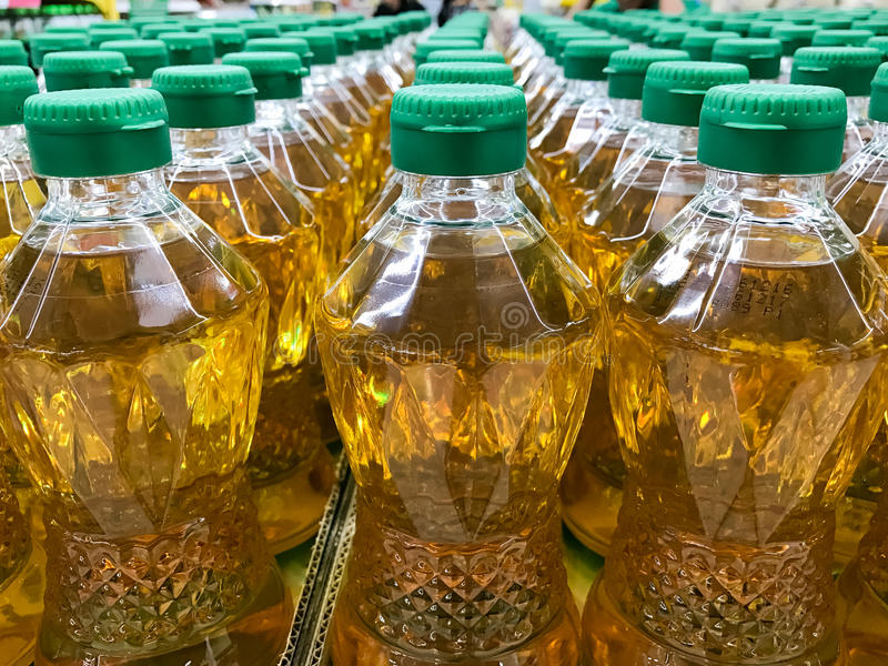 Closed up pile of bottled palm oil. In the market stock images
