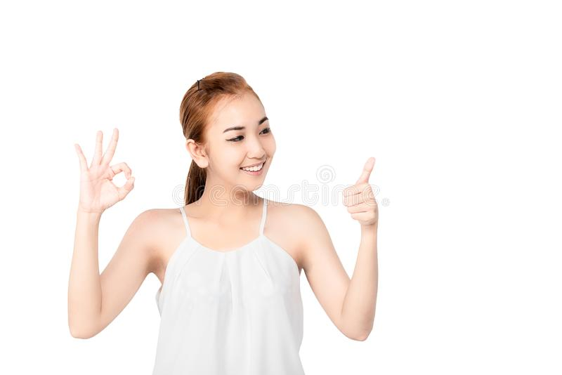 Closed up portrait of cheerful happy excited asian woman wearing a white casual and showing ok sign with beaming smile, clean skin stock photos