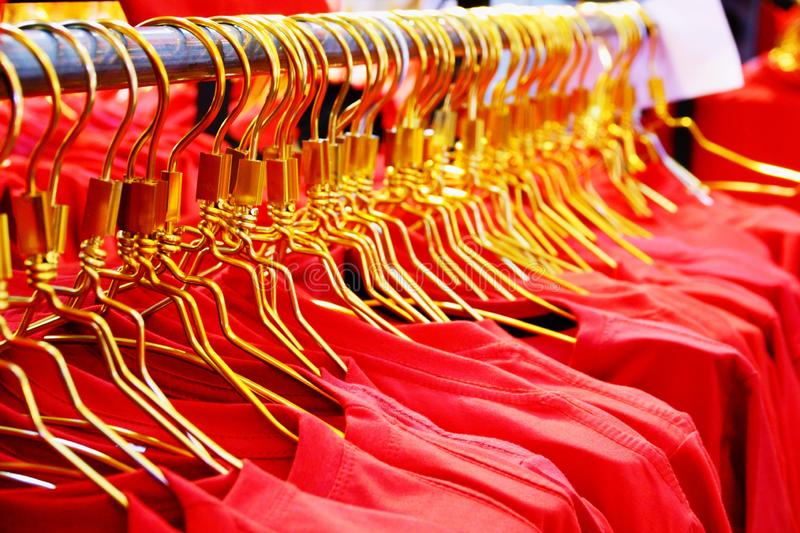 Closed up Red shirts on a rack in the shopping mall stock images