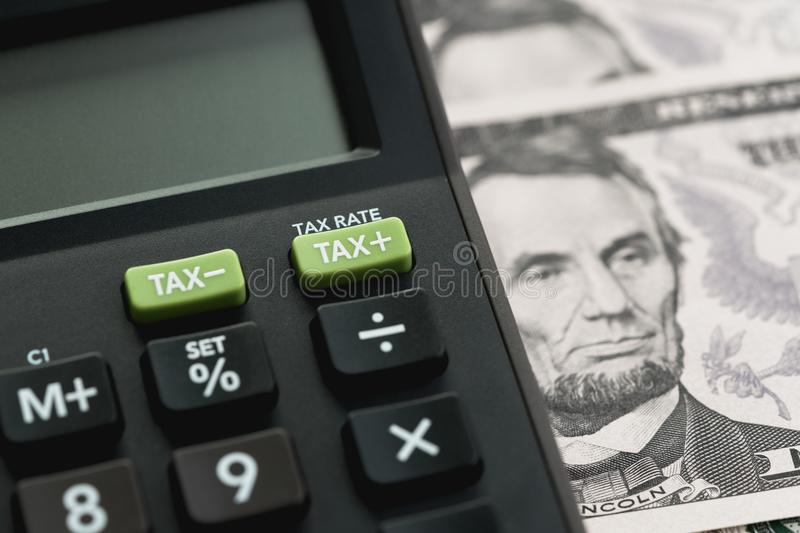 Closed up shot of TAX minus / plus buttons with text TAX RATE on royalty free stock images