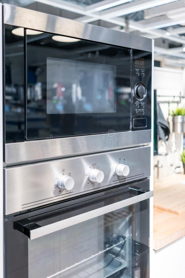 Closed up silver black wall oven with built-in microwave. royalty free stock images