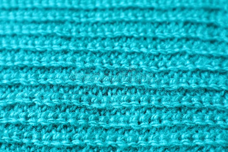Closed Up Texture of Turquoise Blue Alpaca Knitted Wool Fabric in Horizontal Patterns. Abstract background blanket blur blurred blurry bright closeup cloth stock photography