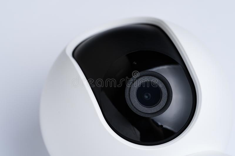 Closed up view of Internet IP video camera with small wide angle lens with white plastic cover using in security monitoring or. Private cctv using internet to royalty free stock image