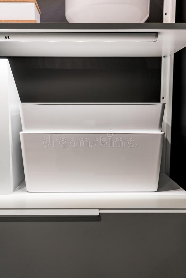 Closed up white storage on shelf and drawer in walkin closet. Against grey wall royalty free stock photography