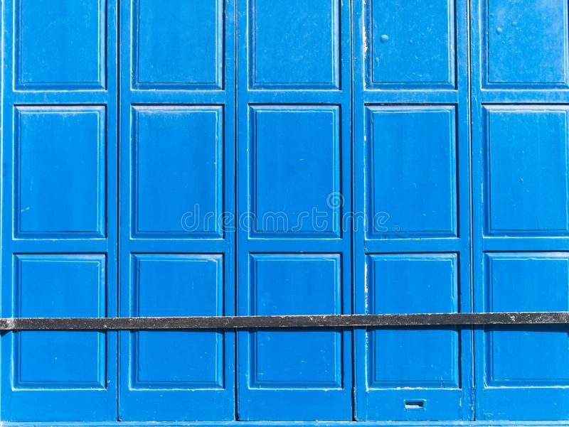 Closed vintage blue wooden shutters royalty free stock images