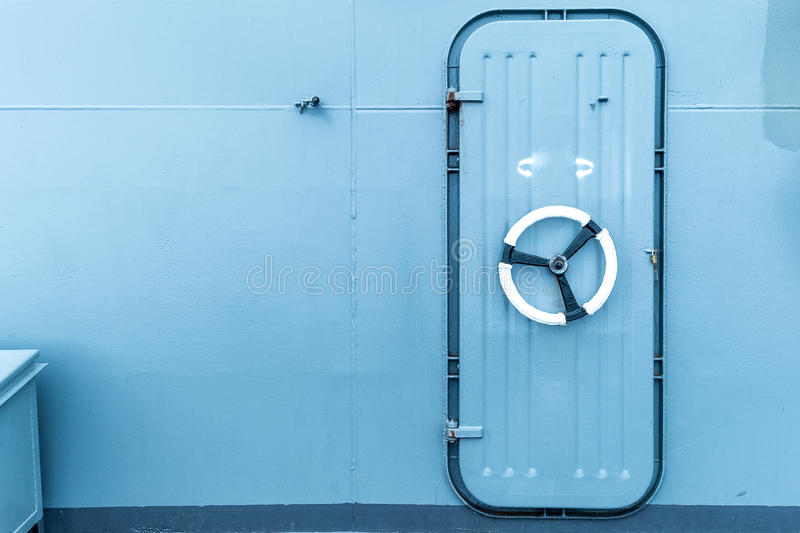 Closed watertight door in a ship stock image