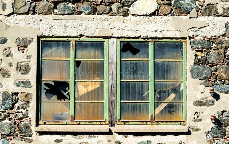 Closed windows with broken glass stock photos