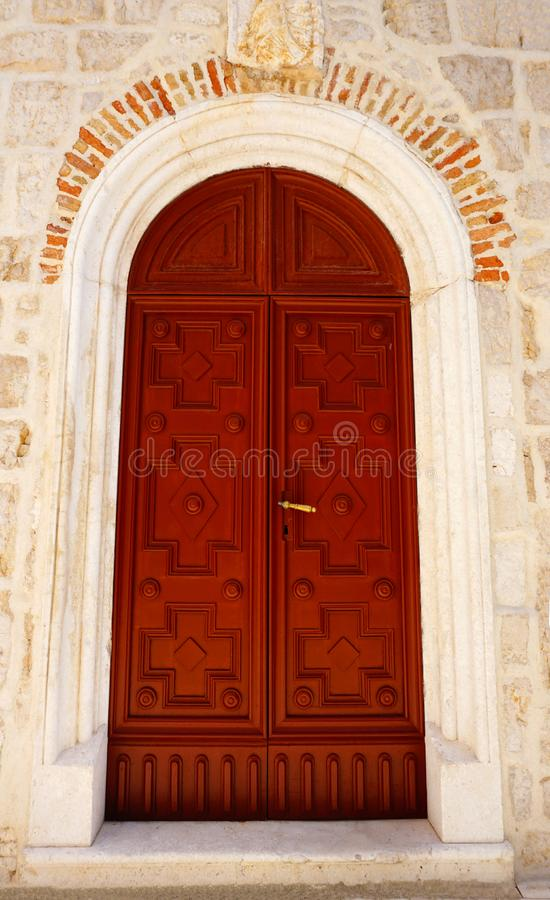 Closed wooden door on the bell tower of the Benedictine monastery of Saint Margarita in the town of Pag, on the Croatian island of. Pag, Croatia, July 8, 2019 stock image